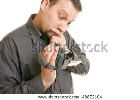 man holding a camera and looking at the display - stock photo