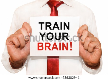 Man holding a card with a text Train Your Brain - stock photo