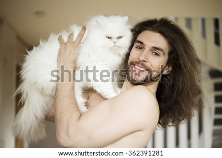 Man holding a cat - stock photo