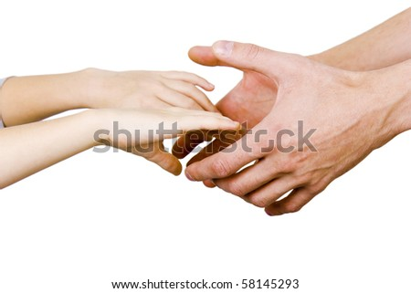 man holding a child's hands on a white background - stock photo