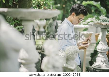 man holding a chocolate cake in garden - stock photo