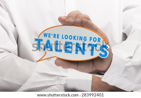 Man holding a comics bubble with the text we are looking for talents. Concept image for illustration of talent recruitment or job opportunities. - stock photo