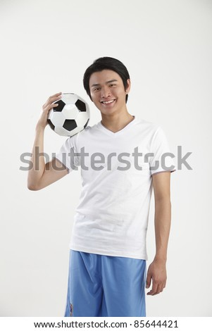 man holding a football at the shoulder