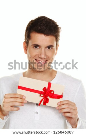 man holding a gift card in his hand. gift certificate. - stock photo