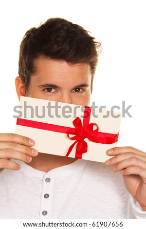 Man holding a gift voucher in his hand. Shopping voucher. - stock photo