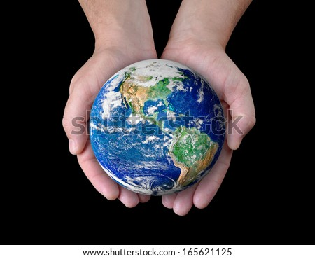 Man holding a globe in his hands. Elements of this image furnished by NASA  - stock photo