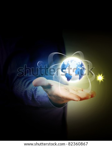 Man holding a glowing earth globe in his hands - stock photo