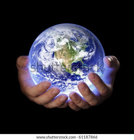 Man holding a glowing earth globe in his hands. Earth image provided by Nasa.