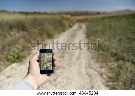 Man holding a GPS device to find the way home - stock photo