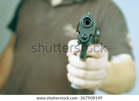 man holding a gun - stock photo