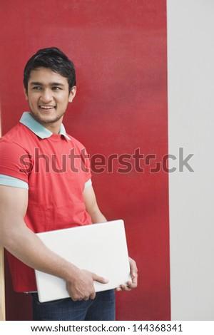 Man holding a laptop - stock photo