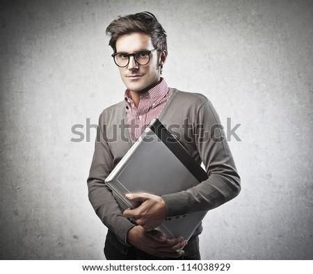Man holding a laptop computer - stock photo