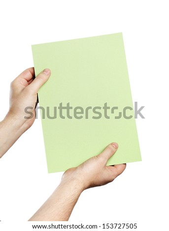 Man holding a light green paper in his hands.