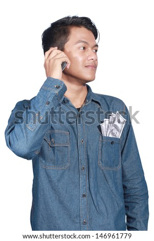 man holding a lot of money and he called his business partner isolated on white background - stock photo