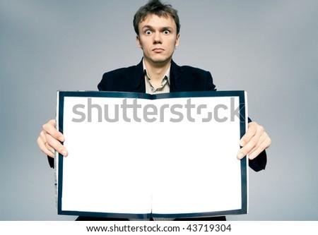 man holding a magazine - stock photo