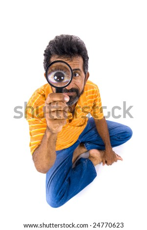 Man holding a magnifying glass on white. - stock photo
