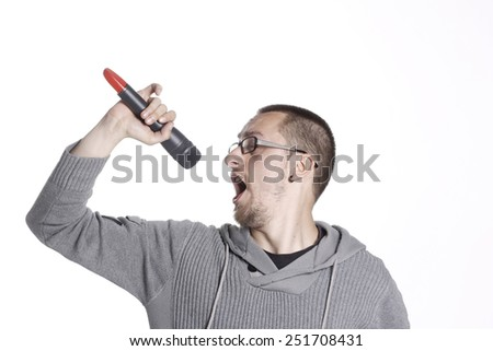 Man Holding a Microphone and Singing loud - stock photo