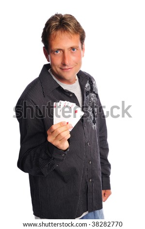 man holding a 4 of a kind shows his poker face - stock photo