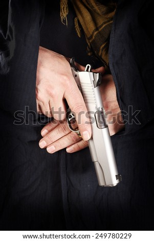 man holding a pistol close up - stock photo