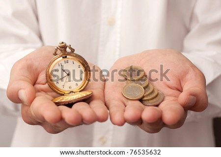 man holding a pocket watch and money - stock photo