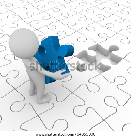 Man holding a puzzle piece - stock photo