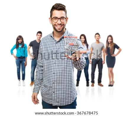 man holding a shopping cart - stock photo