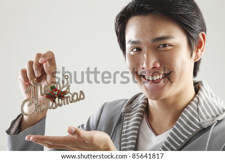 man holding a sign saying ' Merry Christmas' - stock photo