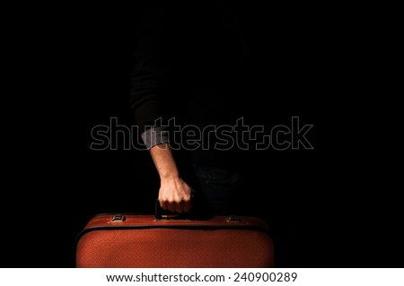 man holding a suitcase for a trip - stock photo