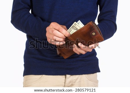 Man Holding a Wallet and Counting Dollar Bills