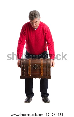 Man holding a weighty trunk