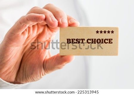 Man holding a wooden rectangle saying Best Choice with a line of five stars depicting good value, 5-star quality and popularity ranking. - stock photo