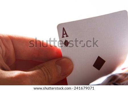 Man holding ace in hand - stock photo