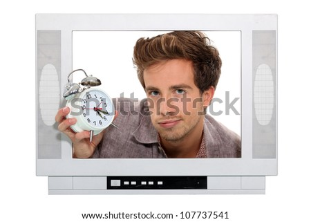Man holding alarm clock trapped in the television - stock photo