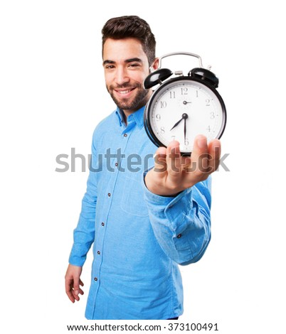 man holding an alarm clock - stock photo