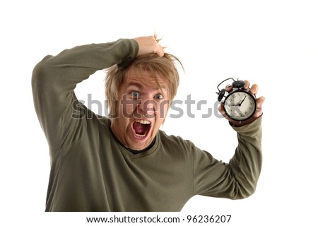 Man holding an alarm clock - stock photo