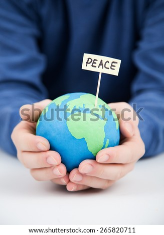 man holding an earth globe, pace - stock photo