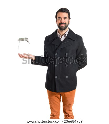 Man holding an empty glass jar