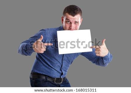 Man holding an empty table, isolated on background - stock photo