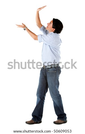 Man holding an imaginary object isolated over a white background