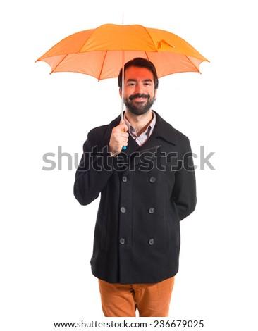 Man holding an umbrella over white background - stock photo