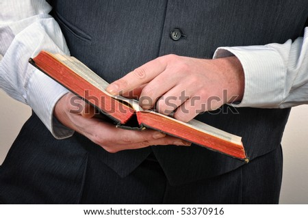 Man holding and reading Holy Bible - stock photo