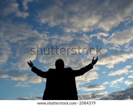 Man holding arms and hands to the skies.