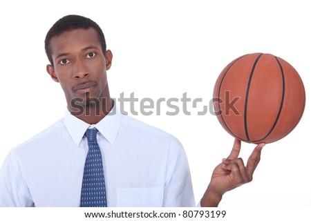 Man holding basketball - stock photo