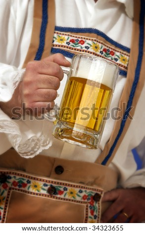man holding beer mug - stock photo