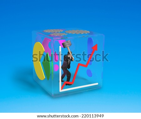man holding big hammer to break glass cube isolated on blue - stock photo
