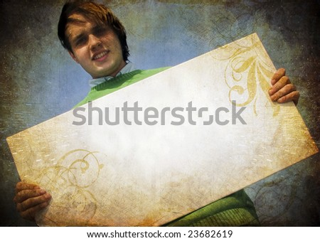 man holding blank cardboard, put your own text here - stock photo