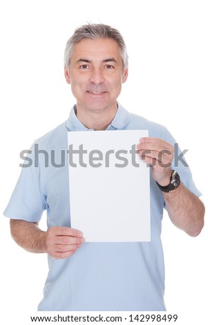 Man Holding Blank Paper Over White Background - stock photo