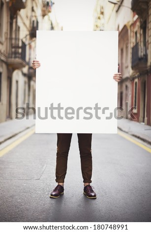 Man holding blank poster  - stock photo