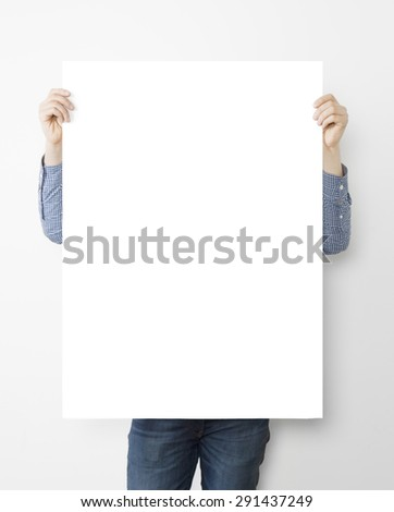 man holding blank poster on white background - stock photo