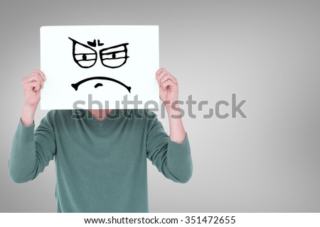 Man holding blank sign in front of face against white background with vignette - stock photo